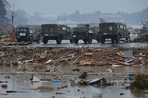 April 9, 2011, Kesennuma, Japan - Military vehicles are parked near the Port of Kesennuma in Miyagi Prefecture, some 400 km northeast of Tokyo, on Saturday, April 9, 2011. Nearly a month after the largest earthquake in Japan recorded history devastated cities, towns, ports and farmlands and the tsunami swallowed up what the quake had missed, thousands of Japanese and American troops are still looking for the 15,000 people who are still formally categorized as missing in Japan northeastern region. (Photo by Koichi Mitsui/AFLO) [3101] -mis-