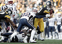 PITTSBURGH, PA - OCTOBER 30:  Heath Miller #83 of the Pittsburgh Steelers runs through tackles with the ball after catching a pass against the New England Patriots during the game on October 30, 2011 at Heinz Field in Pittsburgh, Pennsylvania.  (Photo by Jared Wickerham/Getty Images)