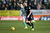17th March 2019, Dens Park, Dundee, Scotland; Ladbrokes Premiership football, Dundee versus Celtic; Martin Woods of Dundee breaks away from Scott Brown of Celtic