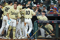 Vanderbilt Commodores teammates celebrate a run scored by Ethan Paul (10) against the Houston Cougars during game nine of the 2018 Shriners Hospitals for Children College Classic at Minute Maid Park on March 3, 2018 in Houston, Texas. The Commodores defeated the Cougars 9-4. (Brian Westerholt/Four Seam Images)