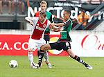 Nederland, Nijmegen, 19 augustus 2012.Eredivisie.Seizoen 2012-2013.N.E.C.-Ajax (1-6).Lasse Schone (l.) en Ryan Koolwijk van N.E.C. strijden om de bal