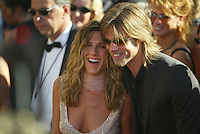 "Jennifer Aniston and Brad Pitt as they arrive at the 2002 Emmys in Los Angeles. The crowd literally roared as the then, ""it,"" couple hit the red carpet."