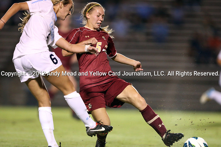 04 October 2012: Boston College's Lauren Bernard (5) blocks a shot by UNC's Summer Green (6). The University of North Carolina Tar Heels defeated the Boston College Eagles 1-0 at Fetzer Field in Chapel Hill, North Carolina in a 2012 NCAA Division I Women's Soccer game.