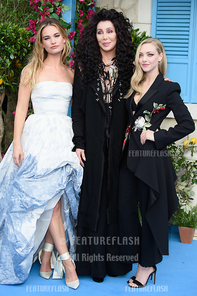 "Lily James, Cher & Amanda Seyfried arriving for the ""Mama Mia! Here We Go Again"" world premiere at the Eventim Apollo, Hammersmith, London, UK. <br /> 16 July  2018<br /> Picture: Steve Vas/Featureflash/SilverHub 0208 004 5359 sales@silverhubmedia.com"