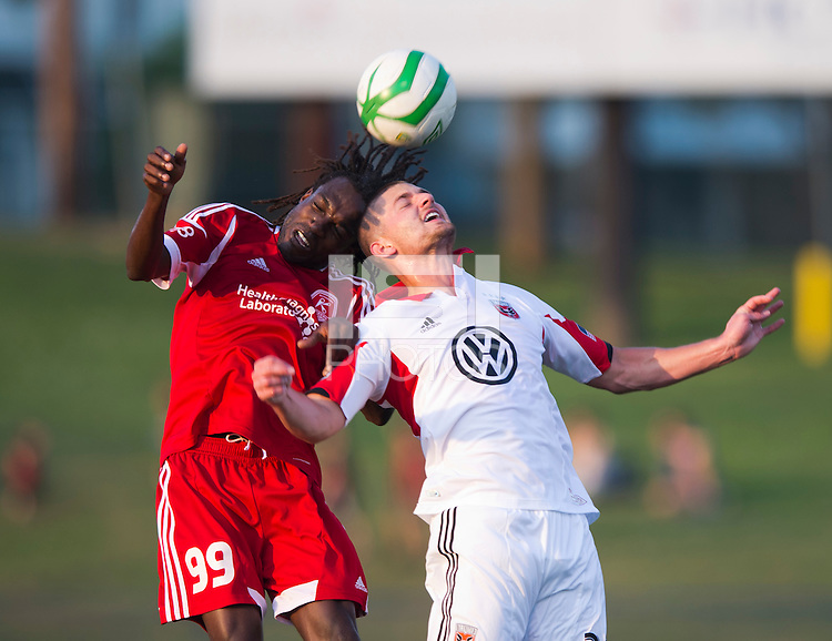 Stanley Nyazamba (99) of the Richmond Kickers goes up for a header with Perry Kitchen (23) of D.C. United during a third round match in the US Open Cup at City Stadium in Richmond, VA.  D.C. United advanced on penalty kicks after tying the Richmond Kickers, 0-0.