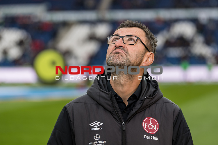 09.02.2019, HDI Arena, Hannover, GER, 1.FBL, Hannover 96 vs 1. FC Nuernberg<br /> <br /> DFL REGULATIONS PROHIBIT ANY USE OF PHOTOGRAPHS AS IMAGE SEQUENCES AND/OR QUASI-VIDEO.<br /> <br /> im Bild / picture shows<br /> Michael K&ouml;llner / Koellner (Trainer 1. FC Nuernberg) blickt skeptisch gen Himmel / nach oben, <br /> <br /> Foto &copy; nordphoto / Ewert