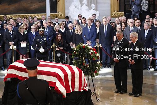 U.S. Senate Majority Leader Mitch McConnell stand at the casket of late U.S. Senator John McCain as McCain lies in state inside the U.S. Capitol Rotunda in Washington, U.S., August 31, 2018. REUTERS/Kevin Lamarque