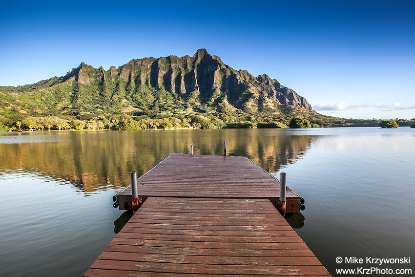 The Ko'olau Mountain Range behind a wooden boat dock on  Moli'i Pond, Secret Island, Oahu