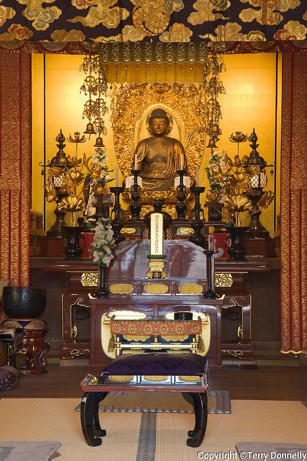 Kyoto City, Japan<br /> Adashino Nenbutsu-ji Temple interior with gold Buddha