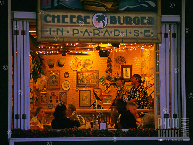 "Waikiki, singers in a night club """"Cheesebugers in Paradise"