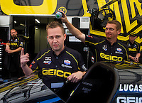 Jun. 1, 2014; Englishtown, NJ, USA; NHRA top fuel driver Richie Crampton and crew members during the Summernationals at Raceway Park. Mandatory Credit: Mark J. Rebilas-