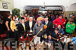 Alan Egan the 2014 King Scallop pictured here with Pipers l-r; Chloe Lyne, Patrick Lyne & Denis O'Reilly sheltering from the rain on Saturday in the Royal Hotel.