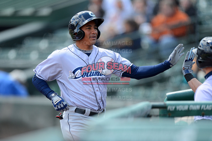 Columbus Clippers outfielder Ezequiel Carrera #10 gets back to the dugout after hitting a lead off home run during a game against the Rochester Red Wings on May 12, 2013 at Frontier Field in Rochester, New York.  Rochester defeated Columbus 5-4.  (Mike Janes/Four Seam Images)