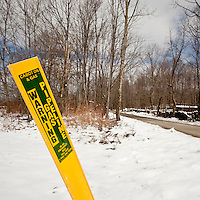 A warning sign indicates the presence of an underground gas pipeline off Carter Road in Dimock, PA, USA, 25 March 2011. Carter Road has become the epicenter of the controversy over the use of so-called fracking to extract natural gas. Several residents have  accused the wells of polluting their drinking water.