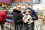 Bridget O'Shea and John Forrest with their dog Tiny at the opening of the Petstop in Manor on Saturday.