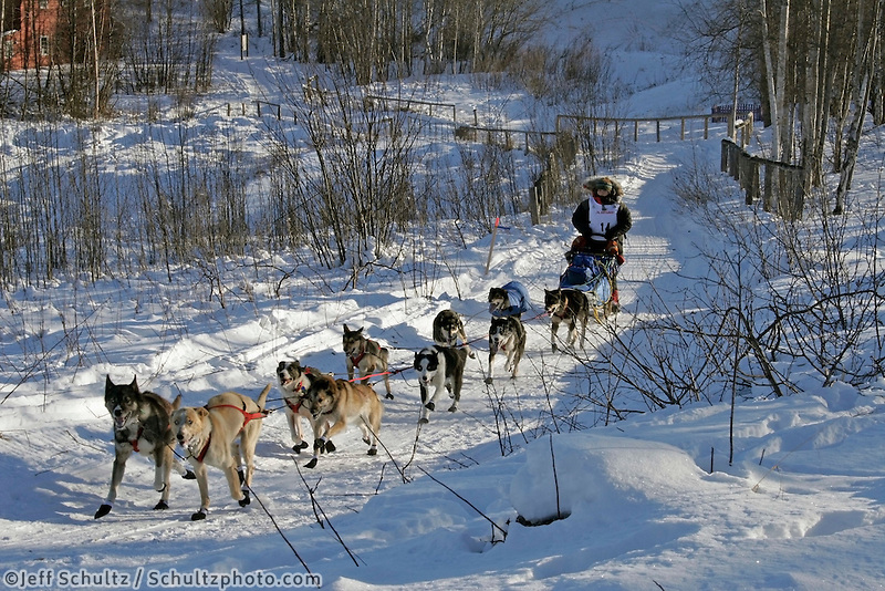 Saturday, February 24th, Knik, Alaska.  Jr. Iditarod musher Chrystiene Lee Salesky on the trail shortly after leaving the Knik start