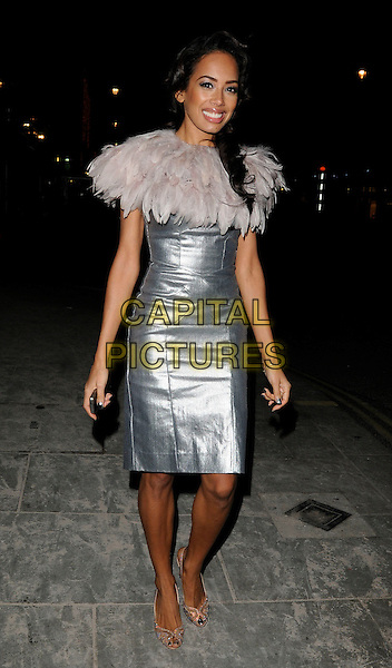 "JADE EWEN of Sugababes .At the ""Sex And The City 2"" DVD Release Party, Swarovski Crystallized Cosmos & Lounge, Gt. Marlborourgh Street, London, England, UK, .29th November 2010..full length silver dress feather cape collar grey gray beige feathers shiny .CAP/CAN.©Can Nguyen/Capital Pictures."