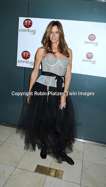 Kelly Killoren Bensimon in Geminelli gray corset and skirt