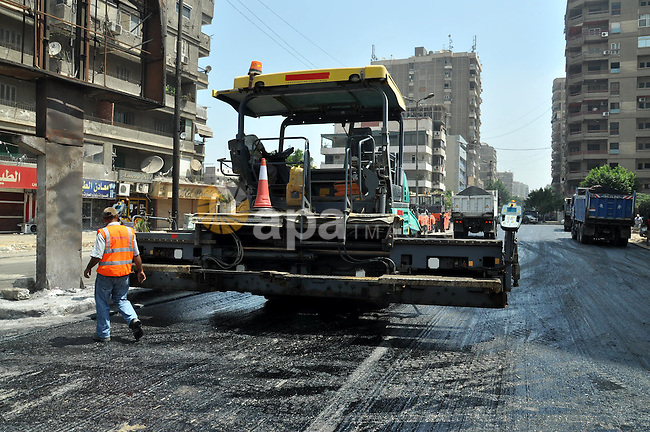 Egyptian workers repair the roads at the Square of Rabaa El Adawiya in Cairo on August 22, 2013. Mubarak may leave jail on Thursday by court order after a week of bloody turmoil in which Egypt's new army-backed rulers cracked down on ousted President Mohamed Mursi's Muslim Brotherhood. Photo by Ahmed Asad