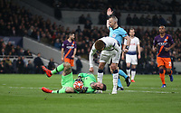 Tottenham Hotspur's Dele Alli checks on the welfare of Manchester City's Ederson<br /> <br /> Photographer Rob Newell/CameraSport<br /> <br /> UEFA Champions League Quarter-finals 1st Leg - Tottenham Hotspur v Manchester City - Tuesday 9th April 2019 - White Hart Lane - London<br />  <br /> World Copyright © 2018 CameraSport. All rights reserved. 43 Linden Ave. Countesthorpe. Leicester. England. LE8 5PG - Tel: +44 (0) 116 277 4147 - admin@camerasport.com - www.camerasport.com