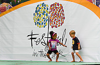 Two children entertain themselves during Festival in the Park. For more than four decades, Charlotte's annual Festival in the Park has brought music, art and fun to Charlotteans and visitors. The festival has been chosen as one of Sunshine Artists Magazine's 200 Best Festivals.