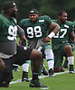 Mike Pennel #98 stretches with teammates during New York Jets Training Camp at the Atlantic Health Jets Training Center in Florham Park, NJ on Monday, Aug. 14, 2017.