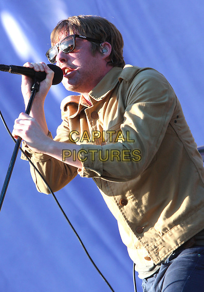 Ricky Wilson of Kaiser Chiefs .Performing live at V festival, Chelmsford, Essex, England, UK, August 20th 2011..music concert gig live on stage half length microphone singing mustard shirt sunglasses jacket denim .CAP/ROS.©Steve Ross/Capital Pictures.