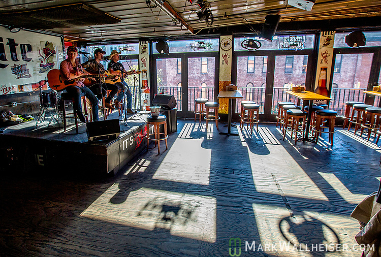 Musicians play on the 3rd floor of the Honkey Tonk on lower Broadway in Nashville, Tennessee