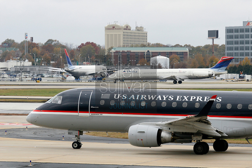 US Airways and Delta planes on the tarmac at Hartsfield-Jackson Atlanta International Airport. US Airways has made a bid to take over Delta Air Lines, which is headquartered in Atlanta.<br />