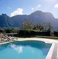 The swimming pool and surrounding terrace has a spectacular view of the dramatic mountain range