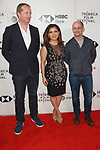 Frida Torresblanco (center), Ed Guiney (right) and guest arrive at the U.S. premiere of the movie Disobedience, on April 22 2018, during the Tribeca Film Festival in New York City.