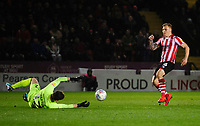Yeovil Town's Nathan Baxter saves from Lincoln City's Harry Anderson<br /> <br /> Photographer Chris Vaughan/CameraSport<br /> <br /> The EFL Sky Bet League Two - Lincoln City v Yeovil Town - Friday 8th March 2019 - Sincil Bank - Lincoln<br /> <br /> World Copyright © 2019 CameraSport. All rights reserved. 43 Linden Ave. Countesthorpe. Leicester. England. LE8 5PG - Tel: +44 (0) 116 277 4147 - admin@camerasport.com - www.camerasport.com