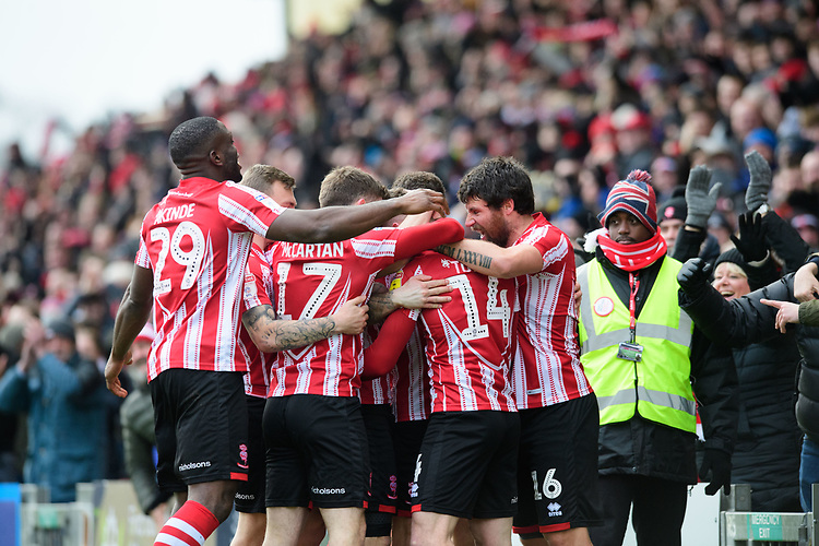Lincoln City's Harry Toffolo, second in from right, celebrates scoring the opening goal with team-mates<br /> <br /> Photographer Chris Vaughan/CameraSport<br /> <br /> The EFL Sky Bet League Two - Lincoln City v Grimsby Town - Saturday 19 January 2019 - Sincil Bank - Lincoln<br /> <br /> World Copyright &copy; 2019 CameraSport. All rights reserved. 43 Linden Ave. Countesthorpe. Leicester. England. LE8 5PG - Tel: +44 (0) 116 277 4147 - admin@camerasport.com - www.camerasport.com