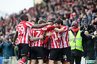 Lincoln City's Harry Toffolo, second in from right, celebrates scoring the opening goal with team-mates<br /> <br /> Photographer Chris Vaughan/CameraSport<br /> <br /> The EFL Sky Bet League Two - Lincoln City v Grimsby Town - Saturday 19 January 2019 - Sincil Bank - Lincoln<br /> <br /> World Copyright © 2019 CameraSport. All rights reserved. 43 Linden Ave. Countesthorpe. Leicester. England. LE8 5PG - Tel: +44 (0) 116 277 4147 - admin@camerasport.com - www.camerasport.com