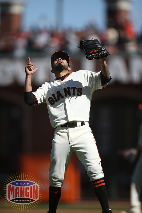 SAN FRANCISCO, CA - MAY 18:  Sergio Romo #54 of the San Francisco Giants celebrates against the Miami Marlins during the game at AT&T Park on Sunday, May 18, 2014 in San Francisco, California. Photo by Brad Mangin