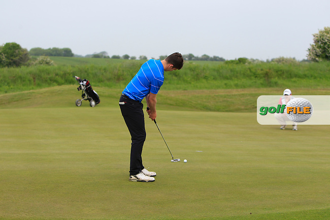 Gareth Carr (Mullingar) on the 18th during Round 2 of the East of Ireland Amateur Open Championship sponsored by City North Hotel at Co. Louth Golf club in Baltray on Sunday 5th June 2016.<br /> Photo by: Golffile | Thos Caffrey