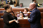 Nevada Assemblywoman Dina Neal, D-North Las Vegas, and Assemblyman Ira Hansen, R-Sparks, work on the Assembly floor at the Legislative Building in Carson City, Nev., on Sunday, May 31, 2015.  <br /> Photo by Cathleen Allison