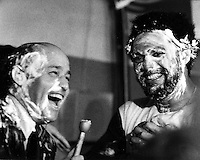 Celebrating after 1972 World Series victory, Joe Garagiola and Reggie Jackson in the A's dressing room  with shaving cream faces following the game.<br />
