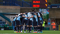 Pre match team huddle during the Sky Bet League 2 match between Wycombe Wanderers and Oxford United at Adams Park, High Wycombe, England on 19 December 2015. Photo by Andy Rowland.