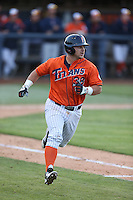 Josh Estill (38) of the Cal State Fullerton Titans runs to first base during a game against the Cal Poly Mustangs at Goodwin Field on April 2, 2015 in Fullerton, California. Cal Poly defeated Cal State Fullerton, 5-0. (Larry Goren/Four Seam Images)