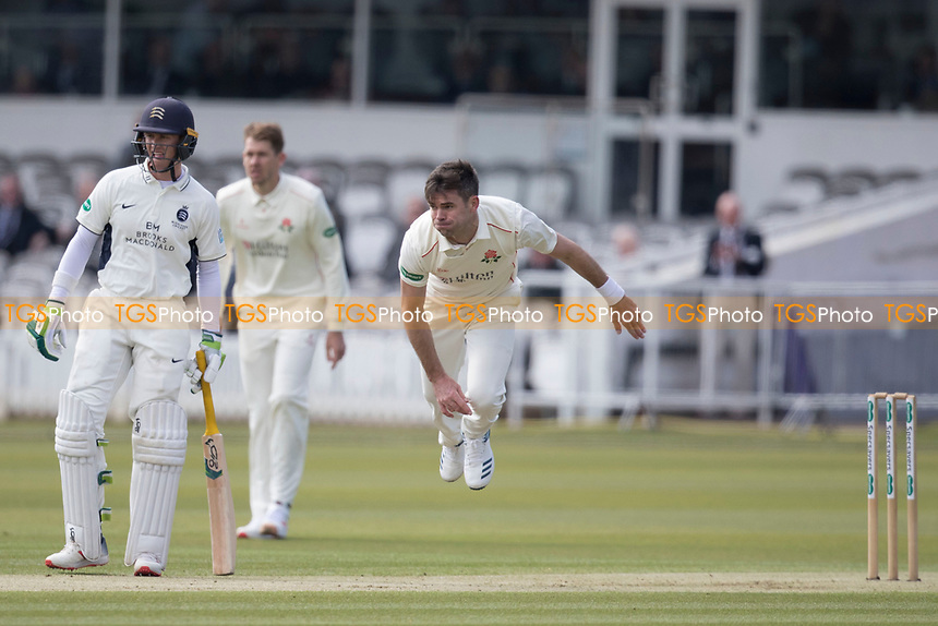 James Anderson of Lancashire CCC follows through as Nick Gubbins looks on during Middlesex CCC vs Lancashire CCC, Specsavers County Championship Division 2 Cricket at Lord's Cricket Ground on 11th April 2019