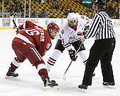 Alex Fallstrom (Harvard - 16), Justin Daniels (Northeastern - 11) - The Northeastern University Huskies defeated the Harvard University Crimson 4-0 in their Beanpot opener on Monday, February 7, 2011, at TD Garden in Boston, Massachusetts.