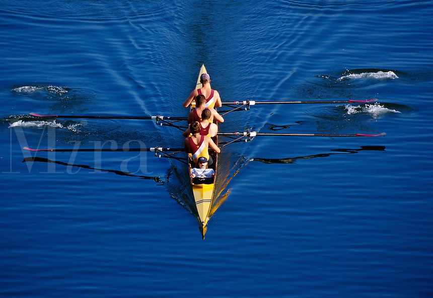 Overview of a team of collegiate rowers as they practice precision rowing technniques.