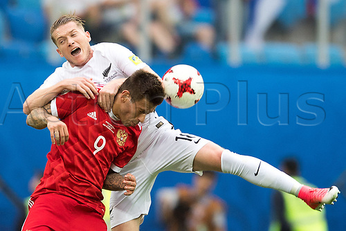 17th June 2017, St Petersburg, Russia; FIFA 2017 Confederations Cup football, Russia versus New Zealand; Group A - Saint Petersburg Stadium,  Russia's Fedor Smolov (l) and New Zealand's Kip Colvey vie for the ball during the Confederations Cup Group A soccer match between Russia and New Zealand at the stadium in Saint Petersburg, Russia