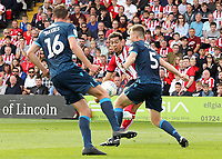Lincoln City's Tyler Walker shoots despite the attentions of Bristol Rovers' Tom Davies and Tony Craig<br /> <br /> Photographer Rich Linley/CameraSport<br /> <br /> The EFL Sky Bet League One - Lincoln City v Bristol Rovers - Saturday September 14th 2019 - Sincil Bank - Lincoln<br /> <br /> World Copyright © 2019 CameraSport. All rights reserved. 43 Linden Ave. Countesthorpe. Leicester. England. LE8 5PG - Tel: +44 (0) 116 277 4147 - admin@camerasport.com - www.camerasport.com