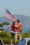 Couple & US flag near Coit Tower