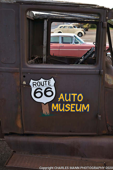 An the window of an ancient truck frames other old cars at the Route 66 Auto Musuem in Santa Rosa, New Mexico
