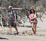 4-4-09 Exclusive.Matthew McConaughey Camila Alves walking on the beach with there baby Levi in Malibu California. Matthew was wearing a Nike Livestrong t-shirt carrying oranges..AbilityFilms@yahoo.com.805-427-3519.www.AbilityFilms.com