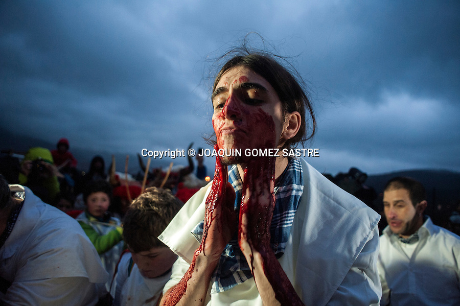A young smeared his face and body with animal blood to exit at the carnival of Alsasua in Navarra.