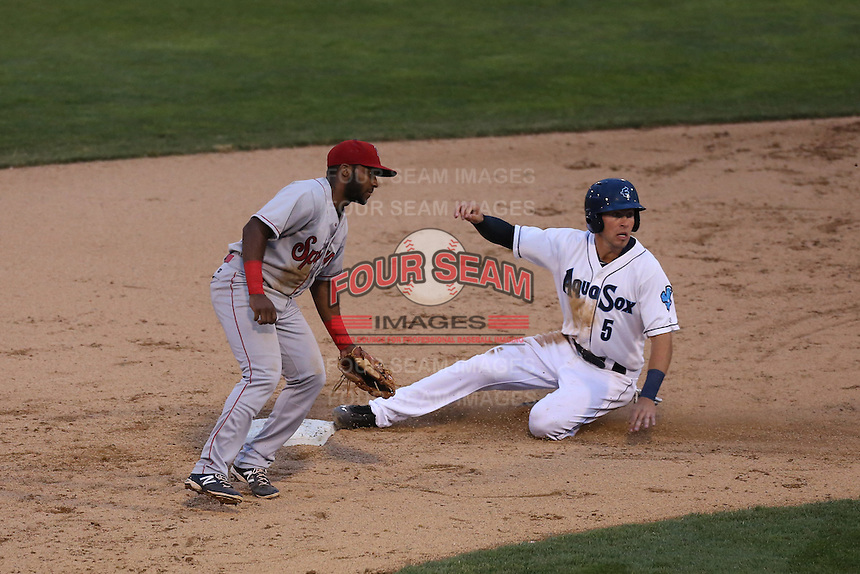 Drew Jackson (5) of the Everett AquaSox steals second base  ahead of the throw to Leon Byrd (4) of the Spokane Indians during a game at Everett Memorial Stadium on July 24, 2015 in Everett, Washington. Everett defeated Spokane, 8-6. (Larry Goren/Four Seam Images)